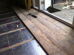 Reclaimed pine flooring layed on screed with insulation